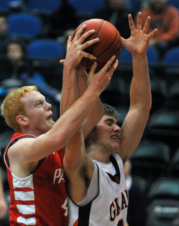 . Lakeville North\'s Bronson Bruneau, left, and  Grand Rapid\'s Alex Illikainen fight for a rebound  in the first half. (Pioneer Press: Scott Takushi)