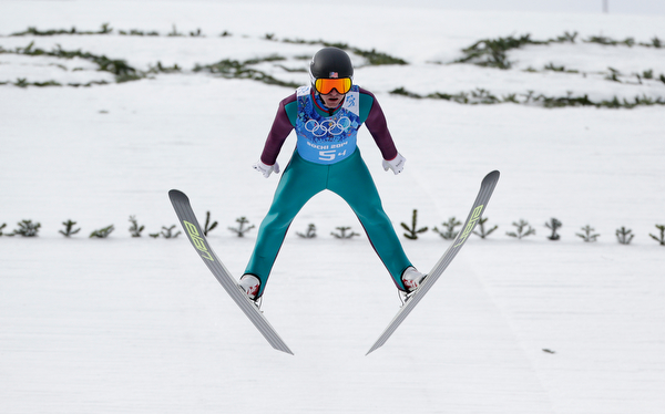 . United States\' Bryan Fletcher makes his trial jump during the ski jumping portion of the Nordic combined Gundersen large hill team competition at the 2014 Winter Olympics, Thursday, Feb. 20, 2014, in Krasnaya Polyana, Russia. (AP Photo/Matthias Schrader)