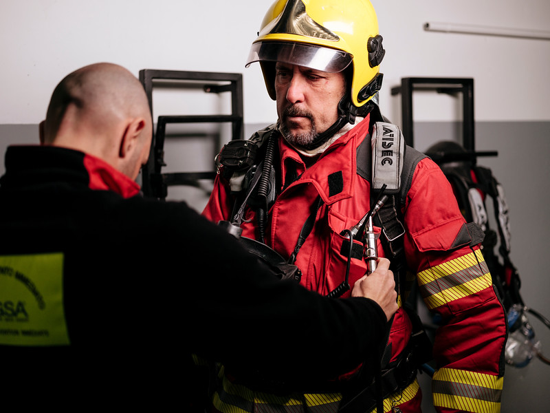 Simone Vesan checking Rudy Fassin direct response crew (professional firefighters) gear in the hangar on the French side - Samuel Zeller for the New York Times