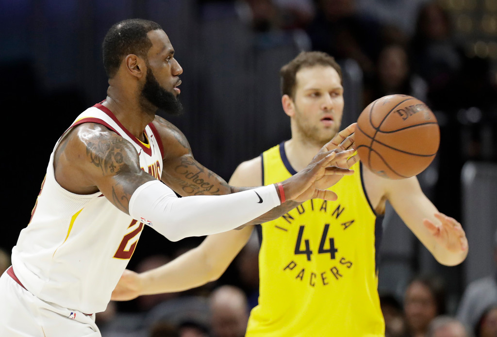. Cleveland Cavaliers\' LeBron James, left, pass against Indiana Pacers\' Bojan Bogdanovic (44), from Croatia, in the second half of an NBA basketball game, Friday, Jan. 26, 2018, in Cleveland. (AP Photo/Tony Dejak)