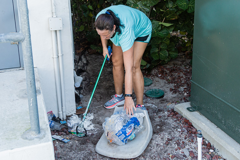 Dana Teagarden of Riviera Beach gathers trash at the Currie Park Marina in West Palm Beach, Sunday, October 11, 2020. Teagarden, along with a group of volunteers is doing their part to clean up to try and clean up the pervasive litter problem in West Palm Beach. (JOSEPH FORZANO / THE PALM BEACH POST)