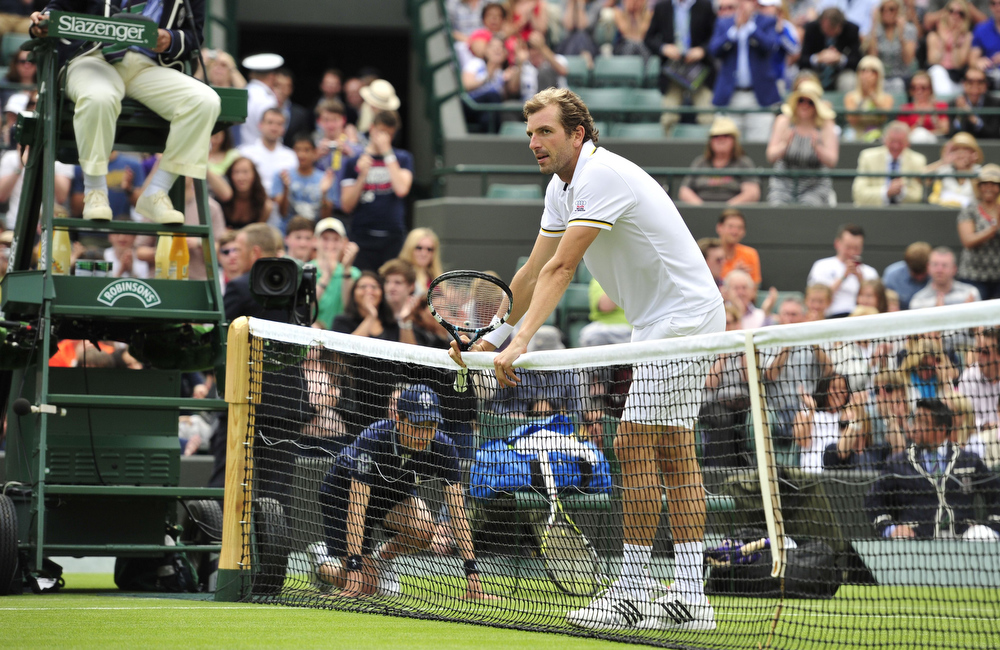 . France\'s Julien Benneteau reacts after losing against Spain\'s Fernando Verdasco during their second round men\'s singles match on day three of the 2013 Wimbledon Championships tennis tournament at the All England Club in Wimbledon, southwest London, on June 26, 2013. Verdasco won 7-6, 7-6, 6-4. GLYN KIRK/AFP/Getty Images