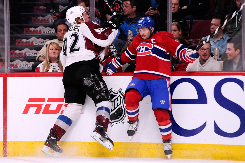 . MONTREAL, QC - MARCH 18:  Gabriel Landeskog #92 of the Colorado Avalanche body checks Brian Gionta #21 of the Montreal Canadiens during the NHL game at the Bell Centre on March 18, 2014 in Montreal, Quebec, Canada.  (Photo by Richard Wolowicz/Getty Images)
