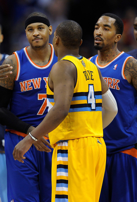. Carmelo Anthony and J.R. Smith walked off the court past Denver guard Randy Foy at the end of the game.    Photo By Karl Gehring/The Denver Post