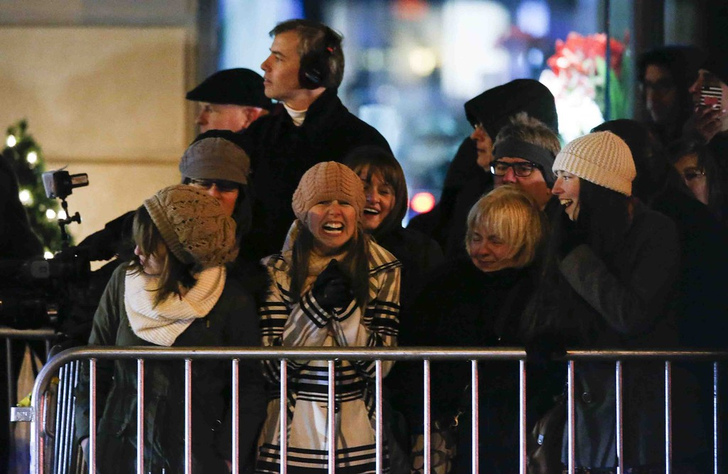 . People await the arrival of the Duke and Duchess of Cambridge outside their Hotel on December 07, 2014 in New York. The three-day US trip will see the Duke and Duchess of Cambridge, both 32, mix diplomacy with supporting their favorite causes and promoting British business interests.KENA BETANCUR/AFP/Getty Images