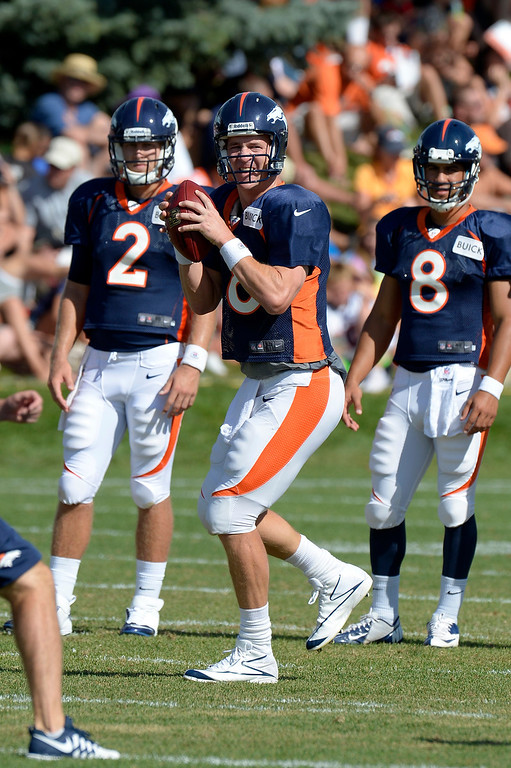 . Denver Broncos QB Peyton Manning (18) drops back to pass during training camp August 6, 2013 at Dove Valley. (Photo By John Leyba/The Denver Post)
