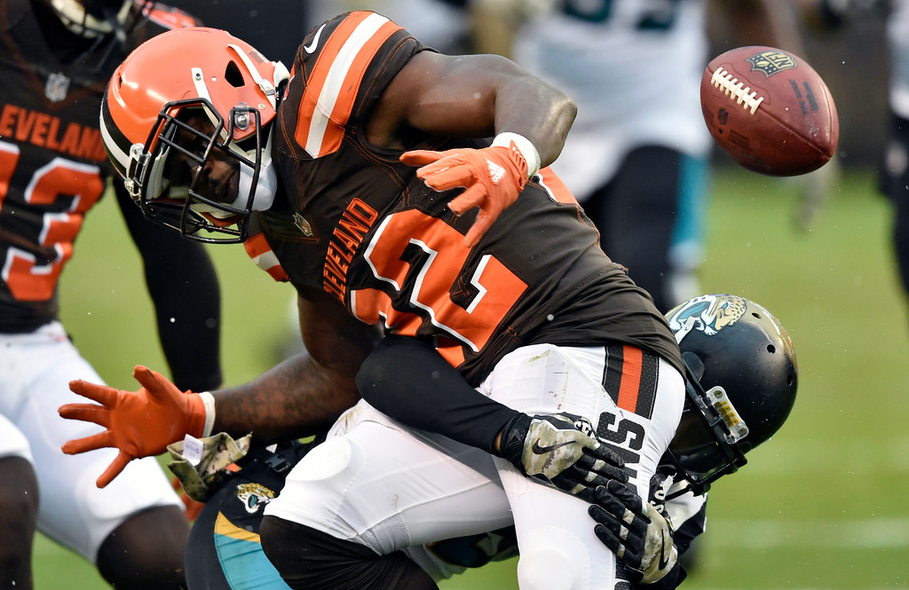 . Cleveland Browns safety Jabrill Peppers (22) fumbles a punt in the second half of an NFL football game against the Jacksonville Jaguars, Sunday, Nov. 19, 2017, in Cleveland. The Jaguars recovered the ball. (AP Photo/David Richard)