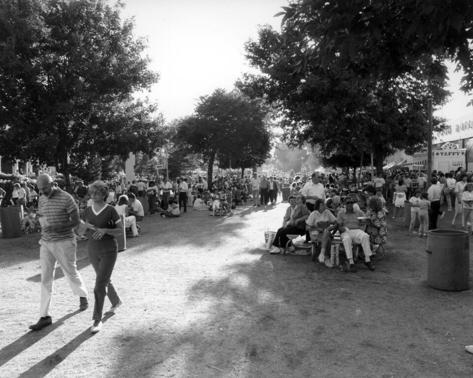 . Shadows attract fairgoers on a hot day during the 1990 Minnesota State Fair, near the Food Building. Photo courtesy of the Minnesota State Fair.