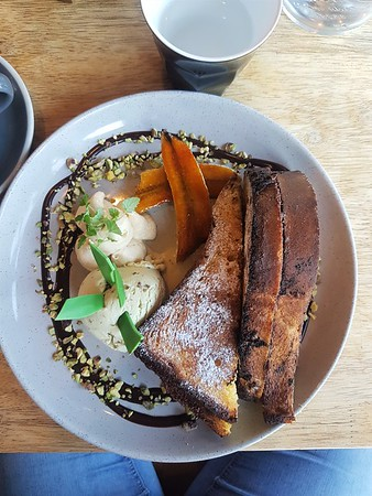 Shot looking down on a plate with nutella filled french toast with ice cream