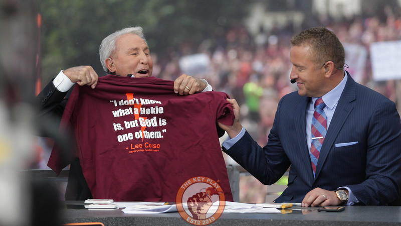 Lee Corso holds up a shirt with his quote from a previous GameDay show at Blacksburg. (Mark Umansky/TheKeyPlay.com)