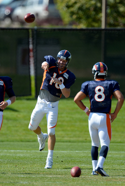 . Denver Broncos quarterback Peyton Manning (18) throws a pass during drills at practice August 20, 2013 at Dove Valley (Photo by John Leyba/The Denver Post)