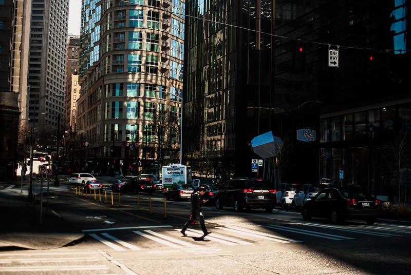 downtown seattle afternoon man crossing.jpg