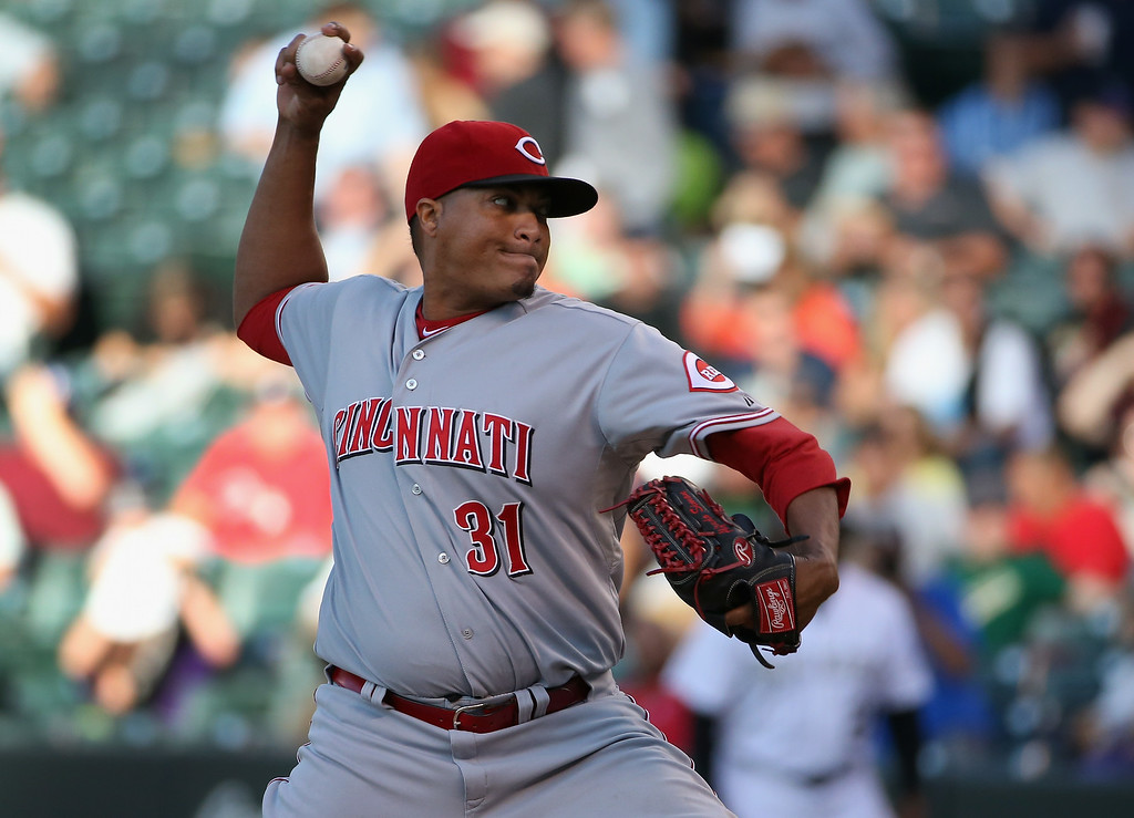 . DENVER, CO - AUGUST 14:  Starting pitcher Alfredo Simon #31 of the Cincinnati Reds delivers against the Colorado Rockies at Coors Field on August 14, 2014 in Denver, Colorado.  (Photo by Doug Pensinger/Getty Images)