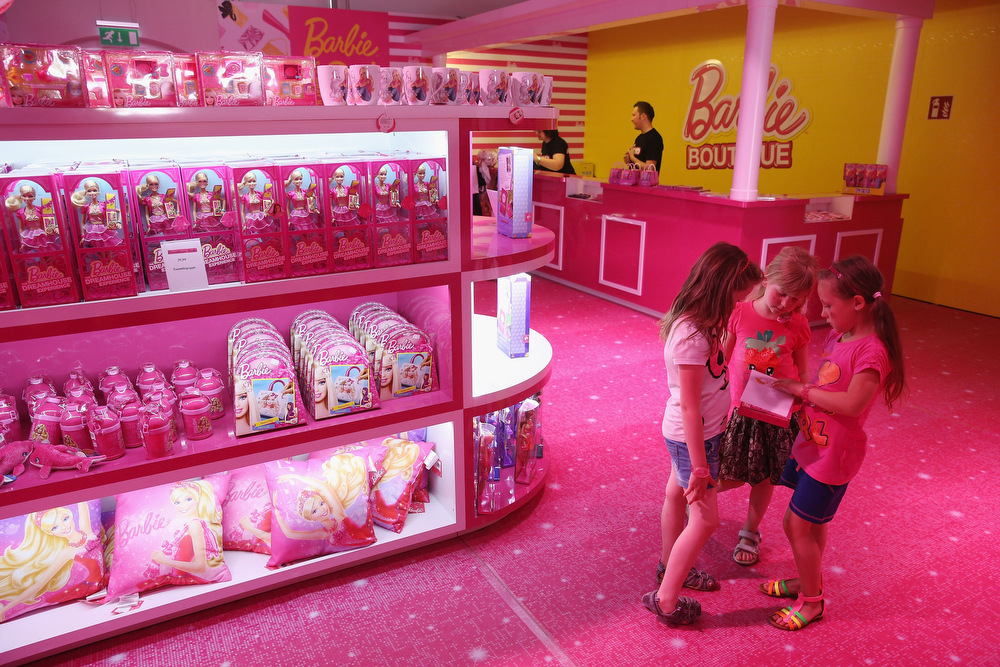 . Visitors Josy, Lara and Luna, all 6 years old, visit the merchandising shop at the Barbie Dreamhouse Experience with her mother on May 16, 2013 in Berlin, Germany. The Barbie Dreamhouse is a life-sized house full of Barbie fashion, furniture and accessories and will be open to the public until August 25 before it moves on to other cities in Europe.  (Photo by Sean Gallup/Getty Images)