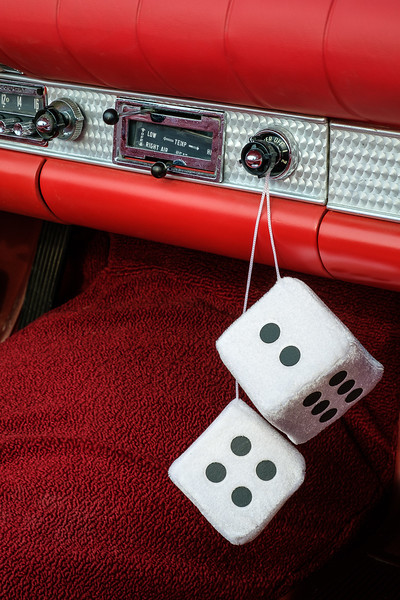 Fuzzy Dice Hanging from Dashboard of a 1957 Ford Thunderbird