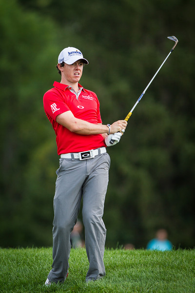 Rory Mciiroy hits out of the rough on the 12th hole during first round action at the BMW Championship at Crooked Stick CC in Carmel Indiana on Thursday Sept. 6, 2012. (Charles Cherney/WGA)
