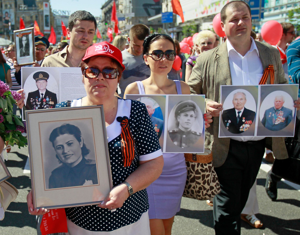""". People holding portraits of their relatives who perished during the World War Two or died later march in the centre of the Ukrainian capital in an improvised \""""Victory Day march\"""" to pay homage to their loved ones in Kiev May 9, 2013. Ukraine commemorates the 68th anniversary of the Soviet Union\'s victory over Nazi Germany on May 9.  REUTERS/Gleb Garanich"""