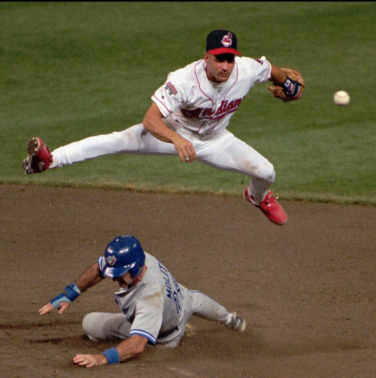. Cleveland Indians\' Omar Vizquel leaps over Toronto runner Paul Molitor during a double play attempt Aug. 30, 1995, in Cleveland. (AP Photo/Mark Duncan)