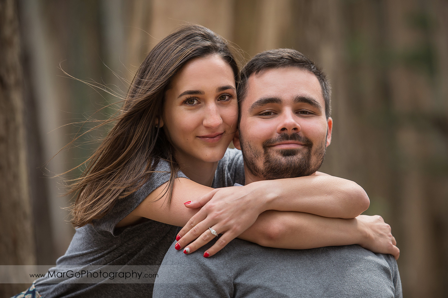engagement session at Lover's Lane at the Presidio in San Francisco - couple hugging in the park