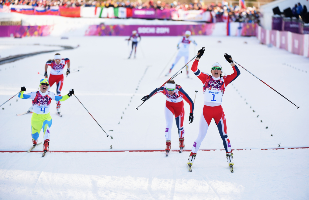 . (L-R) Vesna Fabjan of Slovenia wins third place, Ingvild Flugstad Oestberg of Norway wins second place and, Maiken Caspersen Falla of Norway wins first place in the Finals of the Ladies\' Sprint Free during day four of the Sochi 2014 Winter Olympics at Laura Cross-country Ski & Biathlon Center on February 11, 2014 in Sochi, Russia.  (Photo by Harry How/Getty Images)