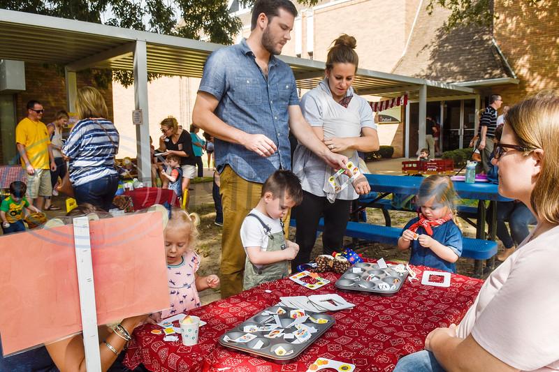 Families make photo frames during the Kids Kaleidoscope Preschool Toddler Fair at Pollard United Methodist Church in Tyler, Texas, on Thursday, Oct. 4, 2018. (Chelsea Purgahn/Tyler Morning Telegraph)