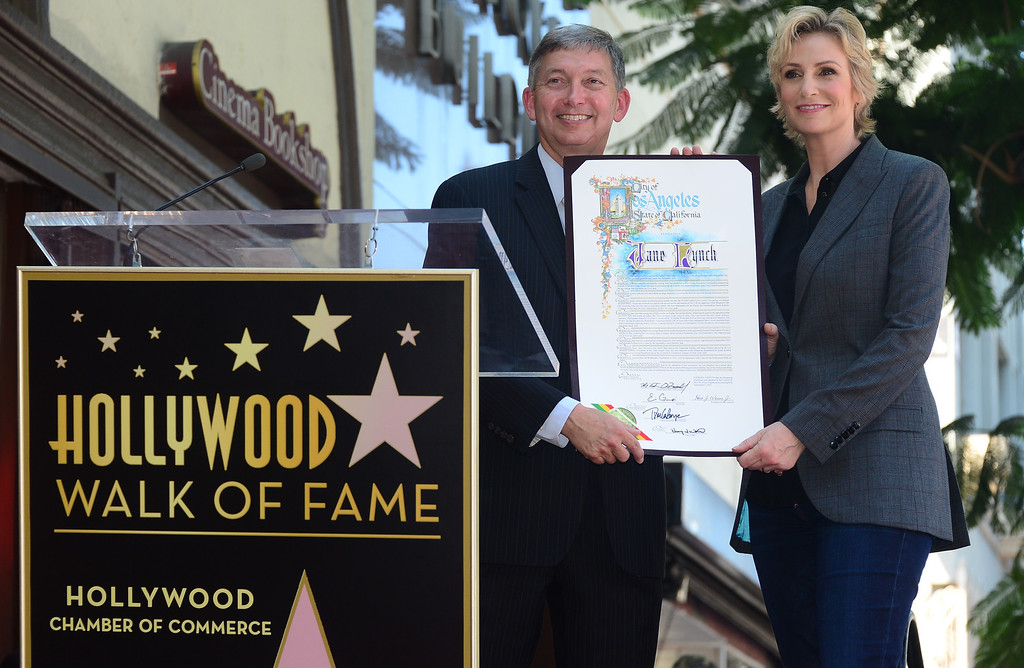 . Actress Jane Lynch poses with ?President & CEO at Hollywood Chamber of Commerce Leron Gubler during a cermony honoring her with the 2,505 Star on the Hollywood Walk of Fame in the category of television on September 4, 2013 in Hollywood, California.        ( FREDERIC J. BROWN/AFP/Getty Images)
