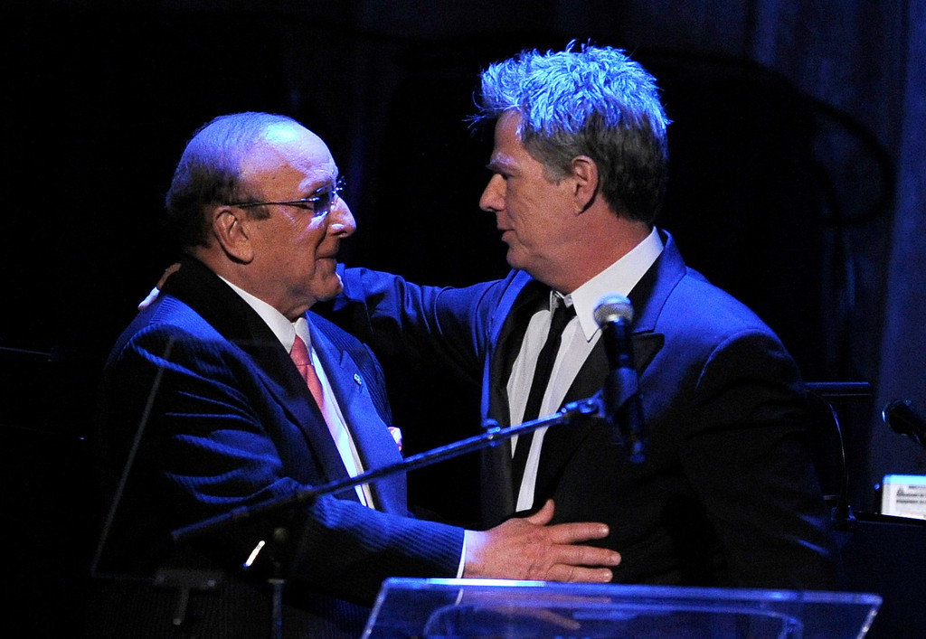 . Clive Davis, left, and David Foster are seen on stage at the pre-Grammy gala & salute to industry icons honoring David Geffen on Saturday, Feb. 12, 2011 in Beverly Hills, Calif. (AP Photo/Mark J. Terrill)