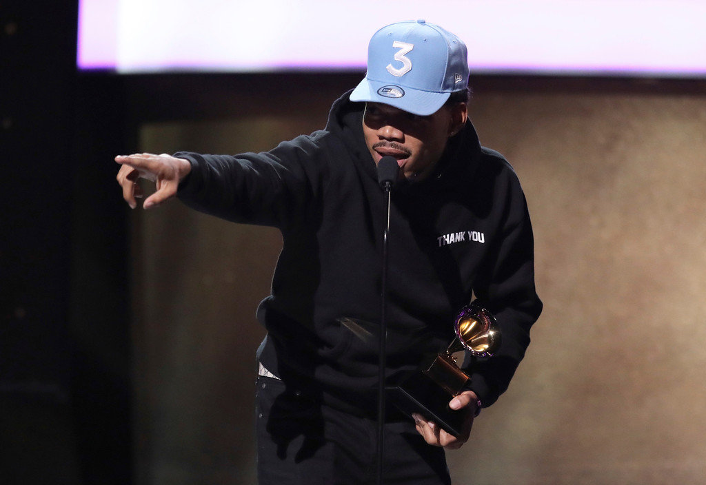 ". Chance The Rapper accepts the award for best rap performance for ""No Problem\"" at the 59th annual Grammy Awards on Sunday, Feb. 12, 2017, in Los Angeles. (Photo by Matt Sayles/Invision/AP)"
