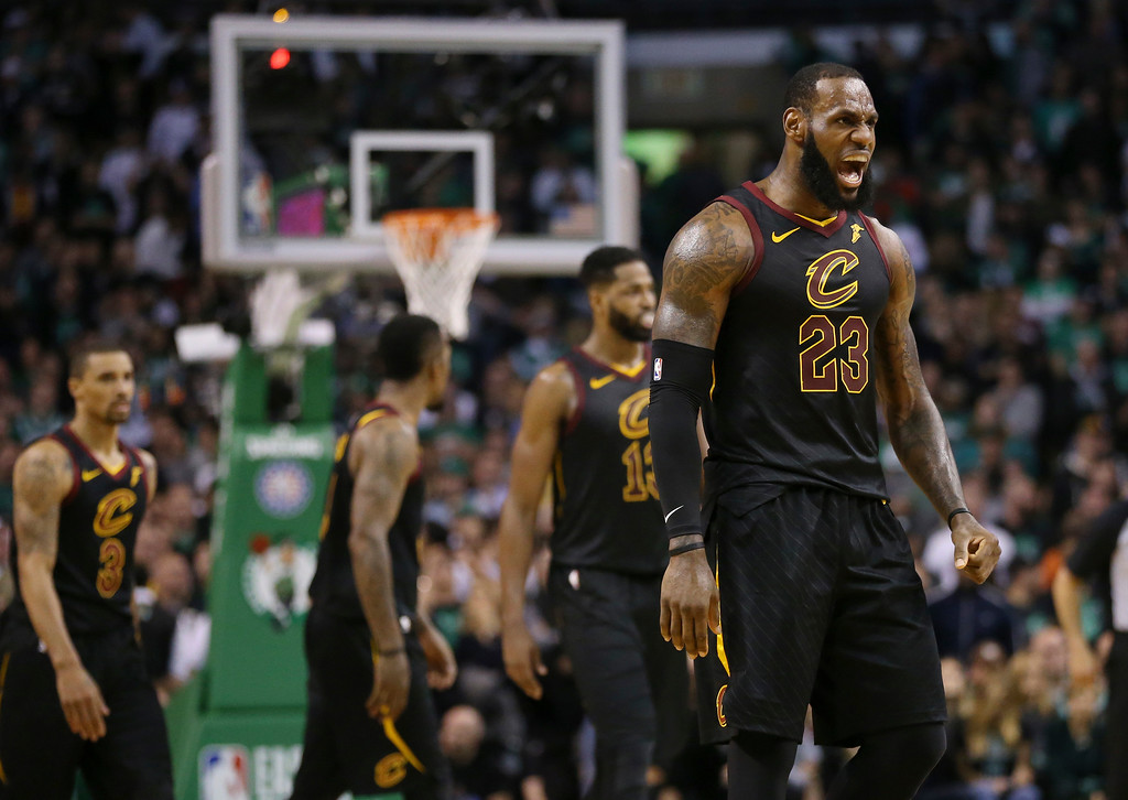 . Cleveland Cavaliers forward LeBron James, right, celebrates a basket during the second half in Game 7 of the NBA basketball Eastern Conference finals against the Boston Celtics, Sunday, May 27, 2018, in Boston. (AP Photo/Elise Amendola)
