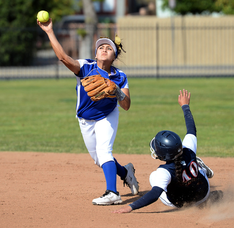 . Bishop Amat shortstop Miranda Larios (#3) forces out St. Paul\'s Bryanna Campos (#40) as she attempts for a double play in their Del Rey League girls softball game at York Field in Whittier on Thursday March 27, 2014. St. Paul defeated Bishop Amat 7-5. (Staff Photo by Keith Durflinger/Whittier Daily News)