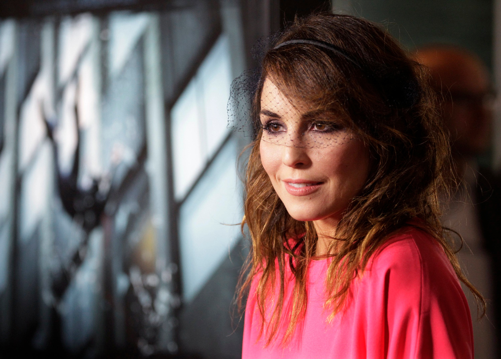 Description of . Swedish actress Noomi Rapace poses at the premiere of her new film
