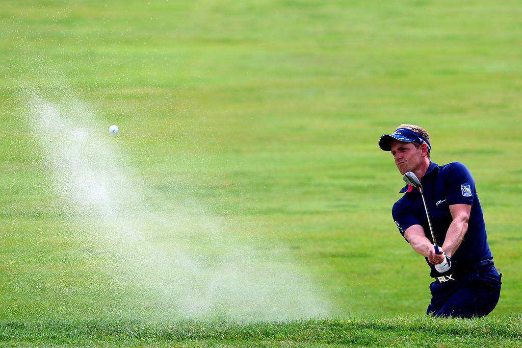 . ARDMORE, PA - JUNE 16:  Luke Donald of England plays his fourth shot on the fourth hole during the final round of the 113th U.S. Open at Merion Golf Club on June 16, 2013 in Ardmore, Pennsylvania.  (Photo by David Cannon/Getty Images)