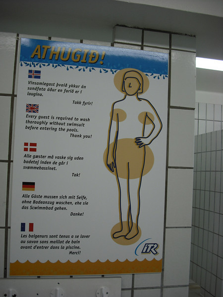 "On day 4, our last day, we went to one of the Reykjavik public baths which are heated by geothermal induction.  Notice the sign here in the bath house.  It says every guest is required to wash thoroughly without a swimsuit before entering the pool.  The picture calls out the ""problem areas"".  What if your knees are dirty?  Can you skip them?"