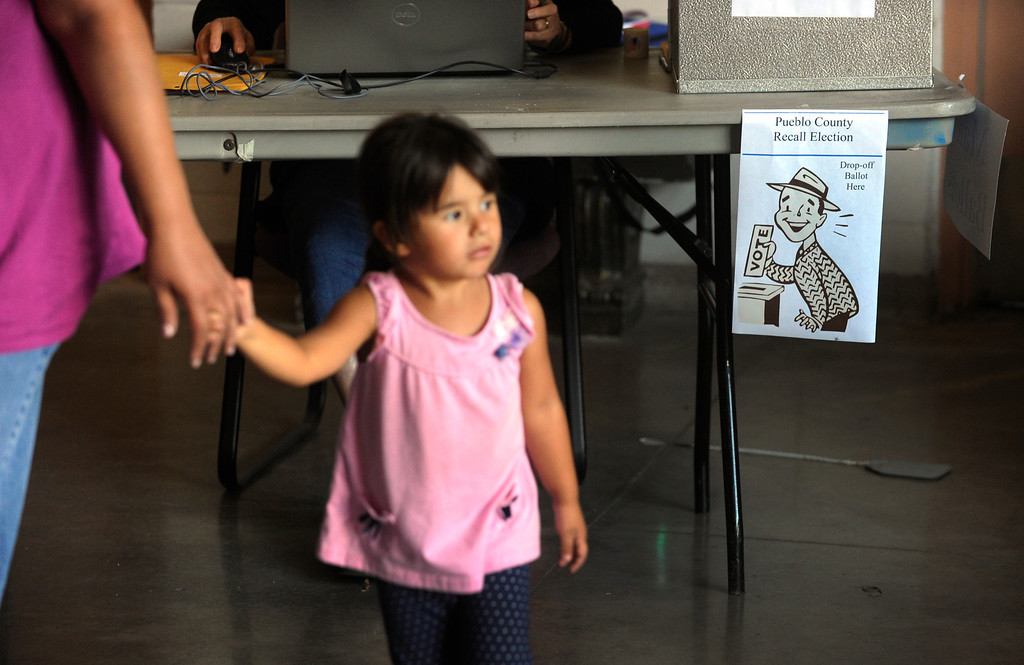 . PUEBLO, CO. - SEPTEMBER 10: Mariposa Valdez, age 3, accompanied her mother Kimberly as she cast her ballot in the recall election on the Colorado State Fairgrounds Tuesday afternoon, September 10, 2013. State Senator Angelo Giron faces a recall in District 3. Photo By Karl Gehring/The Denver Post