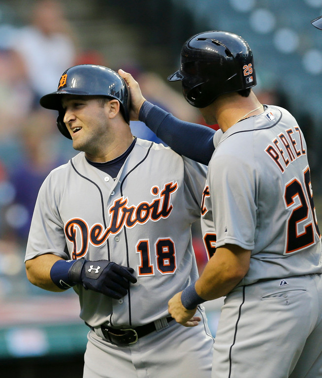 . Detroit Tigers\' Hernan Perez, right, congratulates Tyler Collins after Collins hit a three-run home run off Cleveland Indians relief pitcher Austin Adams in the ninth inning of a baseball game, Monday, Sept. 1, 2014, in Cleveland. Steven Moya and Hernan Perez scored. The Tigers defeated the Indians 12-1. (AP Photo/Tony Dejak)
