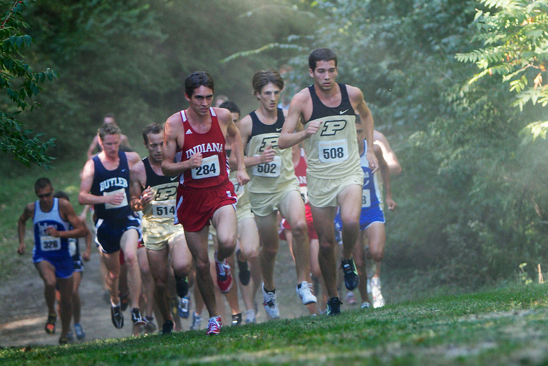 Andy Jessop | Senior Photographer Charles White, Cale Allen, and Stephen Schulz lead the field up a hill 2.5K into the race.
