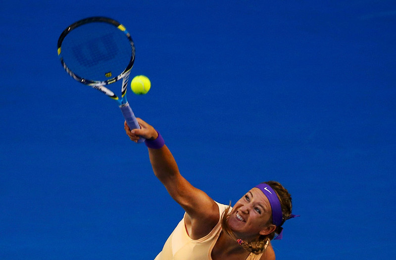 . Victoria Azarenka of Belarus serves to Li Na of China during their women\'s singles final match at the Australian Open tennis tournament in Melbourne, January 26, 2013.  REUTERS/David Gray