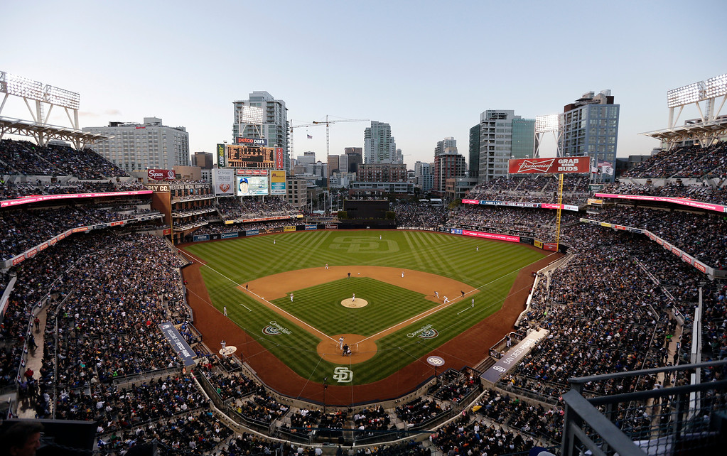 . The San Diego Padres play the Los Angeles Dodgers during the eighth inning of an opening night baseball game on Sunday, March 30, 2014, in San Diego. (AP Photo/Gregory Bull)