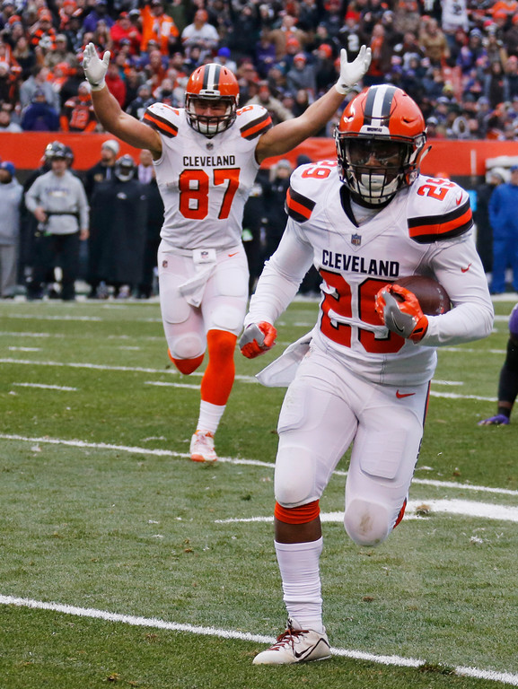 . Cleveland Browns running back Duke Johnson rushes for a 12-yard touchdown during the first half of an NFL football game against the Baltimore Ravens, Sunday, Dec. 17, 2017, in Cleveland. (AP Photo/Ron Schwane)