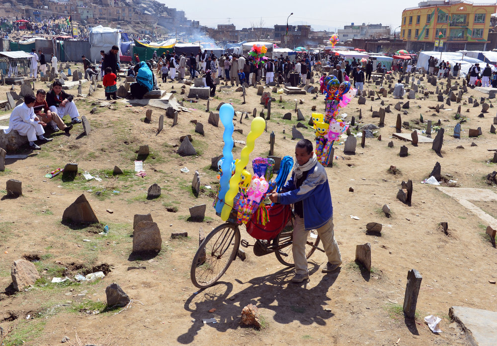 . An Afghan vendor sells balloons near the Sakhi shrine, the centre of the Afghanistan new year celebrations in Kabul during Nowruz festivities on March 21, 2013. Nowruz, one of the biggest festivals of the war-scarred nation, marks the first day of spring and the beginning of the year in the Persian calendar. Nowruz is calculated according to a solar calendar, this coming year marking 1392. MASSOUD HOSSAINI/AFP/Getty Images