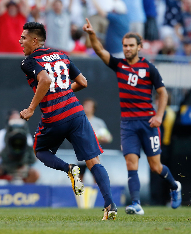 . United States\' Joe Corona (10) celebrates with Graham Zusi (19) after scoring a goal against Nicaragua during a CONCACAF Gold Cup soccer match in Cleveland, Ohio, Saturday, July 15, 2017. (AP Photo/Ron Schwane)