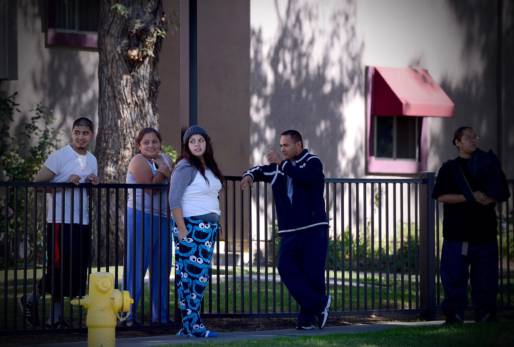 . People watch Pasadena Police investigate an officer involved shooting at Kings Village in Pasadena Friday, October 11, 2013. (Photo by Sarah Reingewirtz/Pasadena-Star News)
