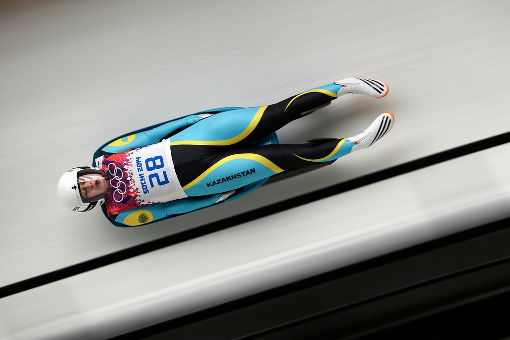 . Yelizaveta Axenova of Kazakhstan speeds down the track in her second run during the women\'s singles luge competition at the 2014 Winter Olympics, Monday, Feb. 10, 2014, in Krasnaya Polyana, Russia. (AP Photo/Michael Sohn)