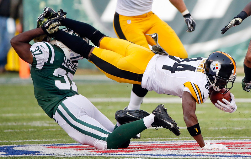 . New York Jets free safety Jaiquawn Jarrett (37) tackles Pittsburgh Steelers\' Antonio Brown (84) during the first half of an NFL football game Sunday, Nov. 9, 2014, in East Rutherford, N.J. (AP Photo/Kathy Willens)