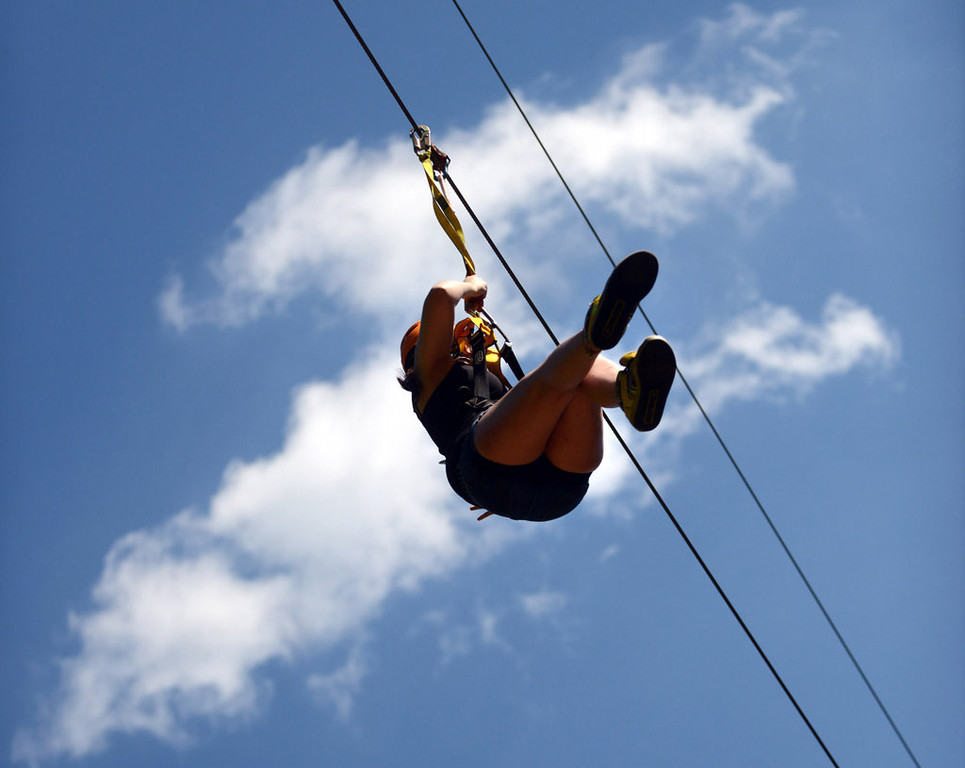 . A rider on the zip line at the Aerial Adventure Park at Trollhaugen. (Pioneer Press: Chris Polydoroff)
