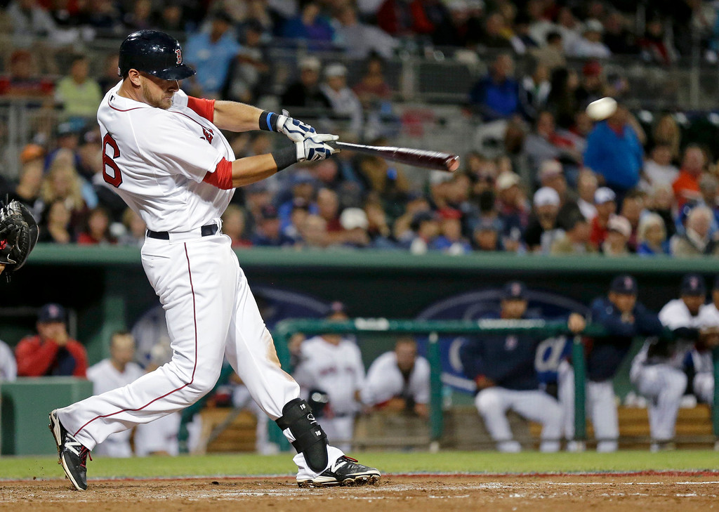 . Boston Red Sox Will Middlebrooks hits an RBI double to bring in the go-ahead run in the seventh inning. (AP Photo/Gerald Herbert)
