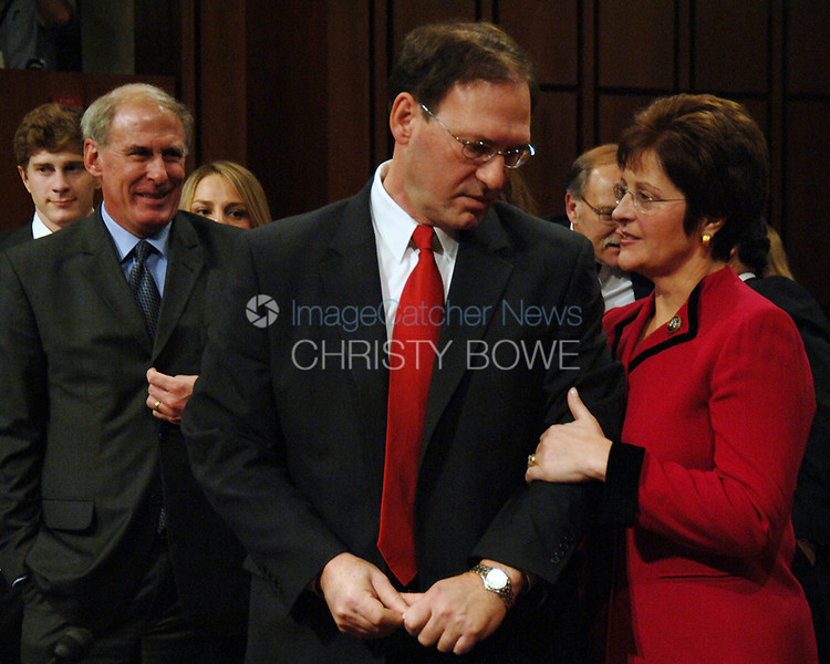 Supreme Court Justice nominee Samuel Alito speaks with his wife during a break in his confirmation hearing.