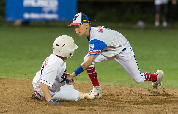 08/09/19 Wesley Bunnell | Staff New Jersey defeated Washington, DC on Friday August 9, 2019 in a Little League Baseball Eastern Regional Tournament game with New Jersey heading to the final on Saturday to face New York. New Jersey's Sal Garcia (1) attempts the tag on DC's Jackson Loomis (9) but Loomis would beat the tag.