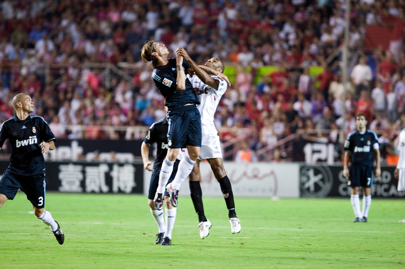 Sergio Ramos and Kanoute jumping. Spanish League game between Sevilla FC and Real Madrid, Sanchez Pizjuan Stadium, Seville, Spain, 4 October 2009