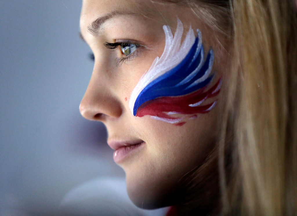 . A Russian fan wears face paint while attending men\'s curling competition at the 2014 Winter Olympics, Monday, Feb. 17, 2014, in Sochi, Russia. (AP Photo/Robert F. Bukaty)